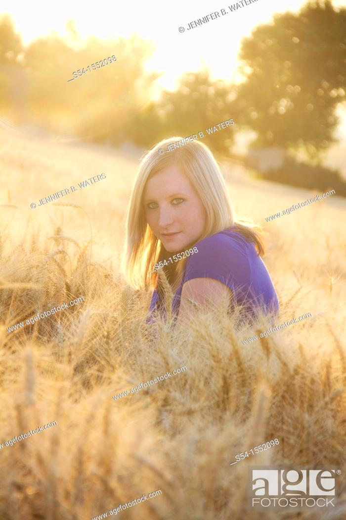 Stock Photo: A happy young woman at a farm in Lewiston, Idaho, USA.