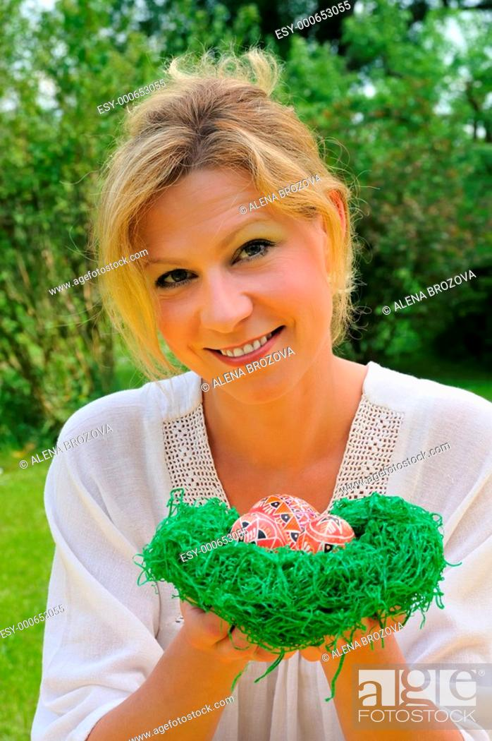 Stock Photo: Young woman and easter eggs.