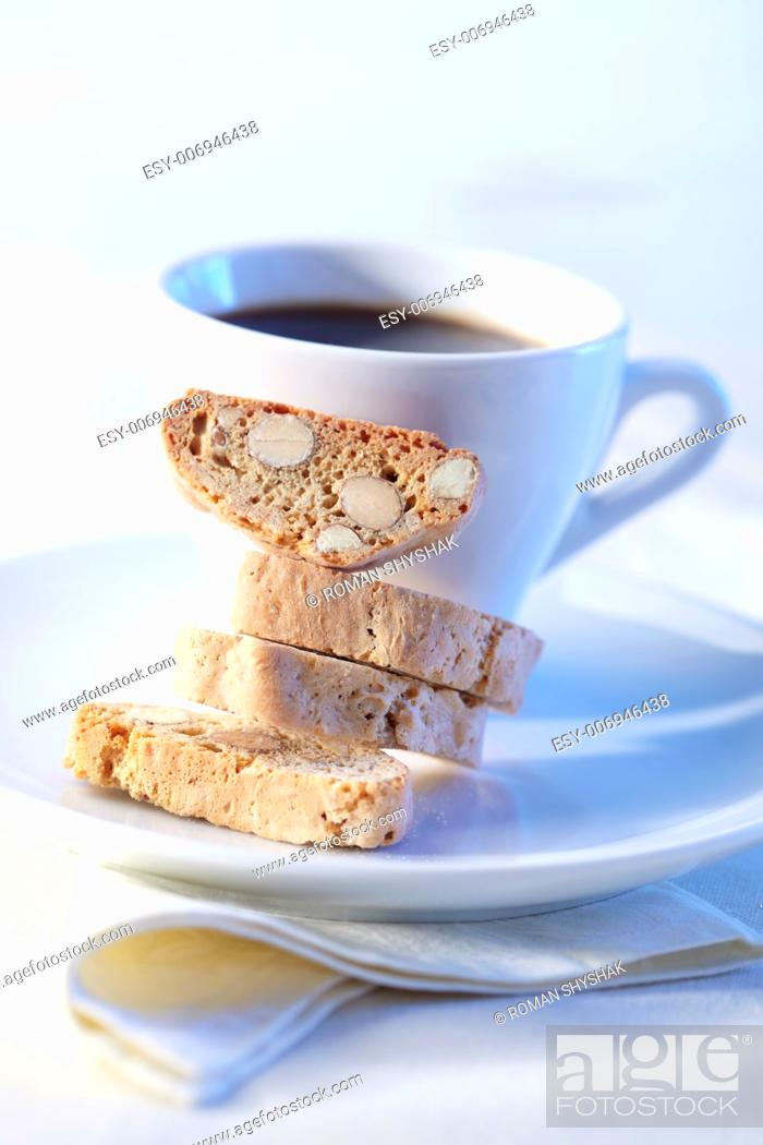 Stock Photo: Cantucci cakes with coffee on background.