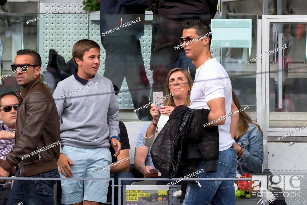 Stock Photo - Portugal and Real Madrid striker Cristiano Ronaldo attends  the Mutua Madrid Open Quarter Final between Rafael Nadal and João Sousa  Featuring  ... 456b53073