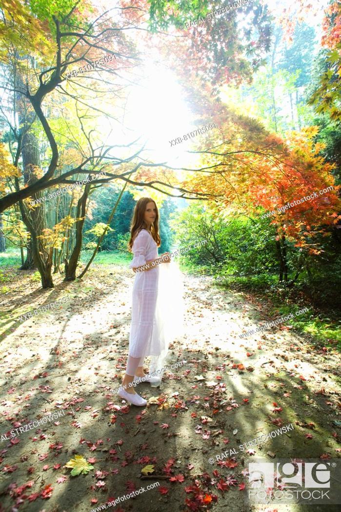Stock Photo: Joyful ginger woman in park.