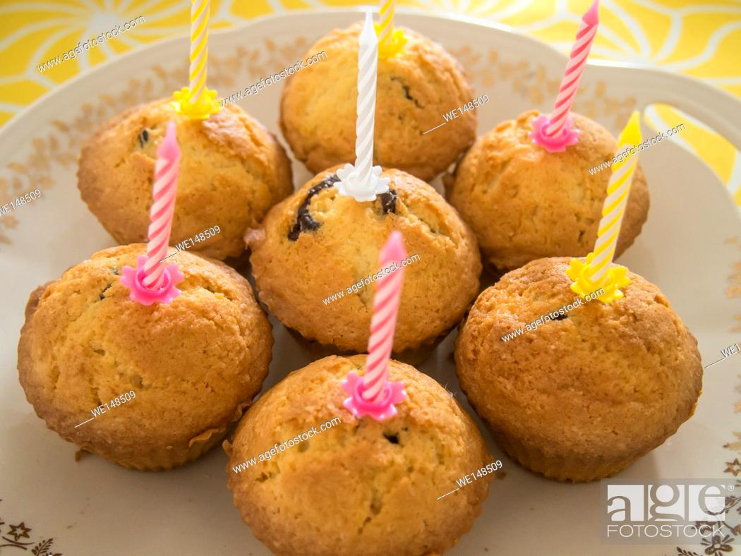 Stock Photo: Cupcakes with candles made for birthday celebration.