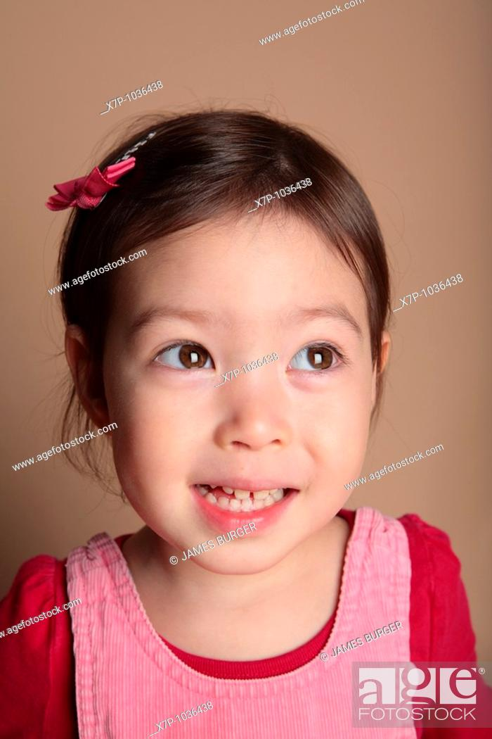 Stock Photo: young girl smiling.