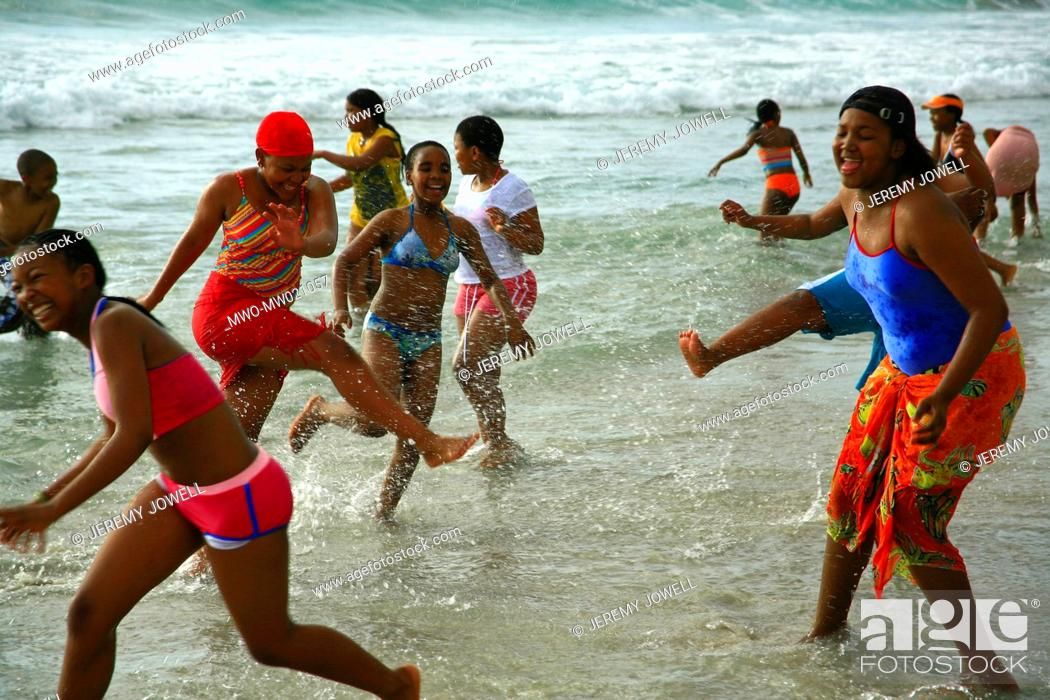Stock Photo: schoolchildren enjoy their first time ever at the ocean, Camps Bay beach, Cape Town, South Africa 10-09-2007.