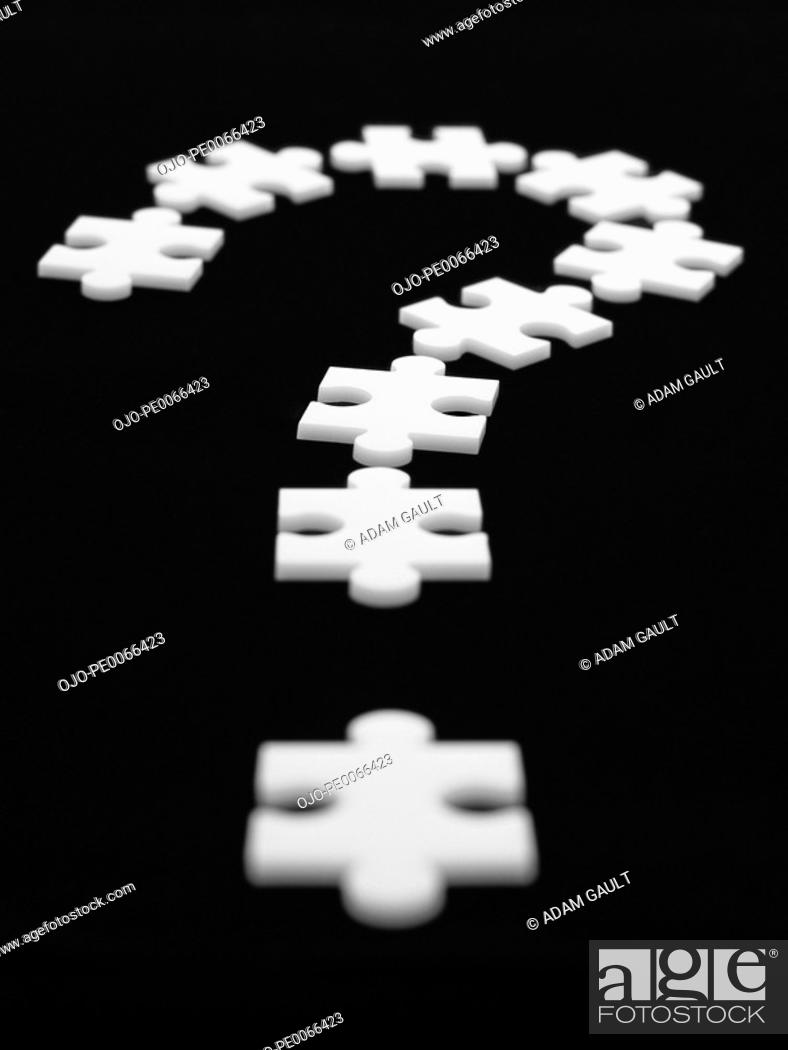 Stock Photo: Puzzle pieces in shape of question mark.
