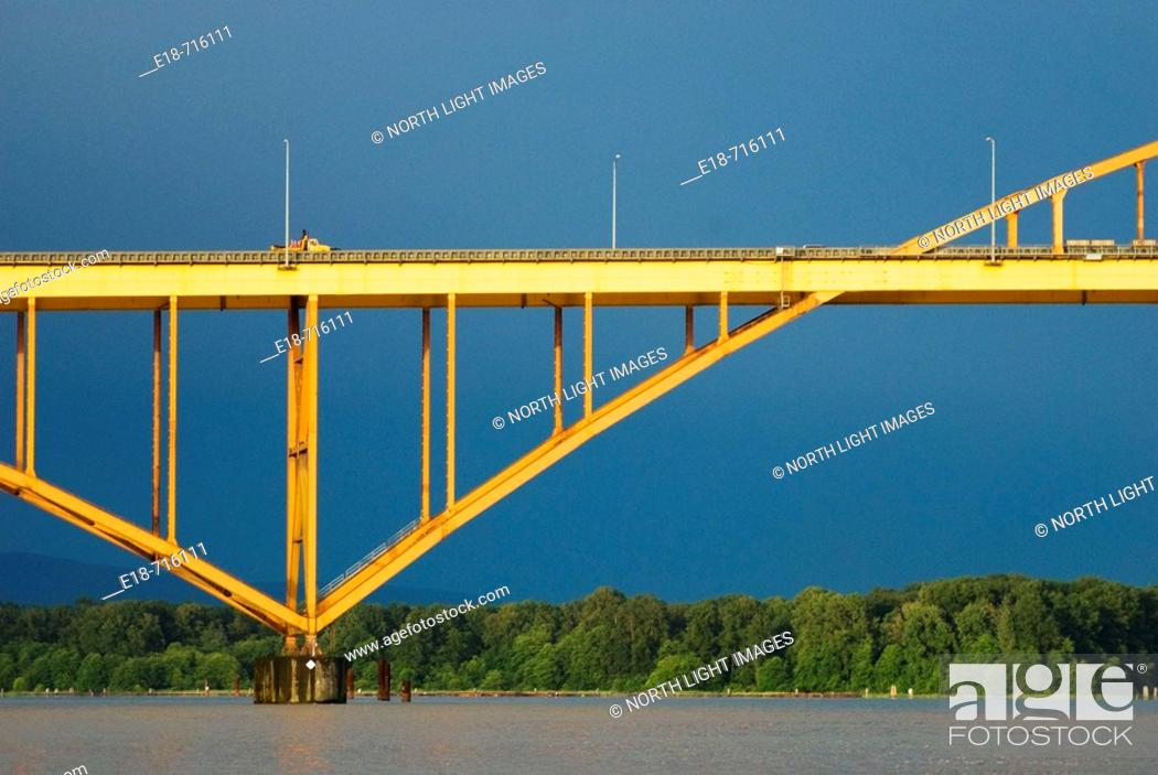 Stock Photo: The Port Mann Bridge spanning the Fraser River between Port Coquitlam and Surrey, BC, Canada.
