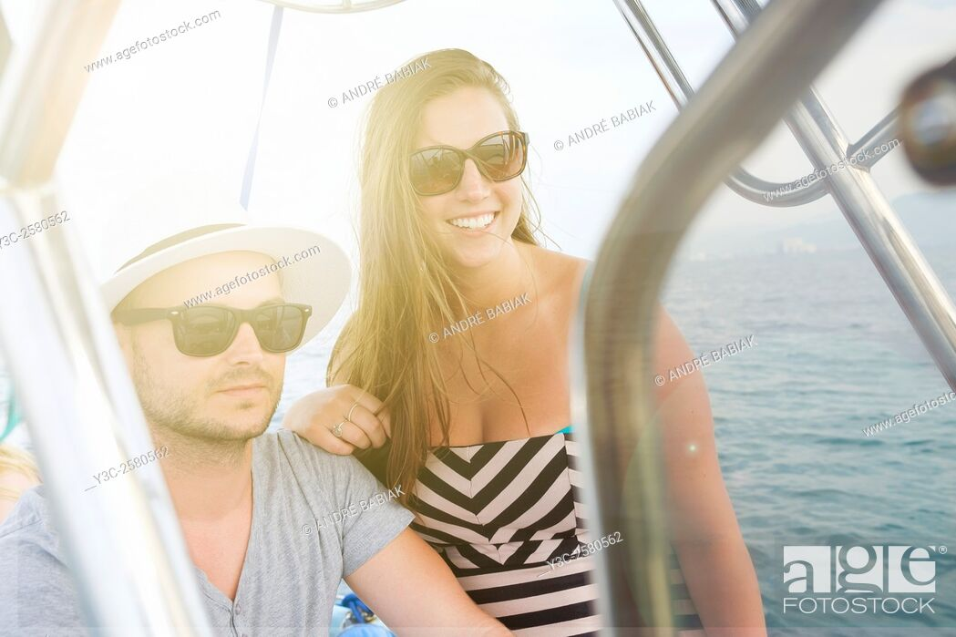 Stock Photo: Young man and young woman enjoying a boat ride on vacation.