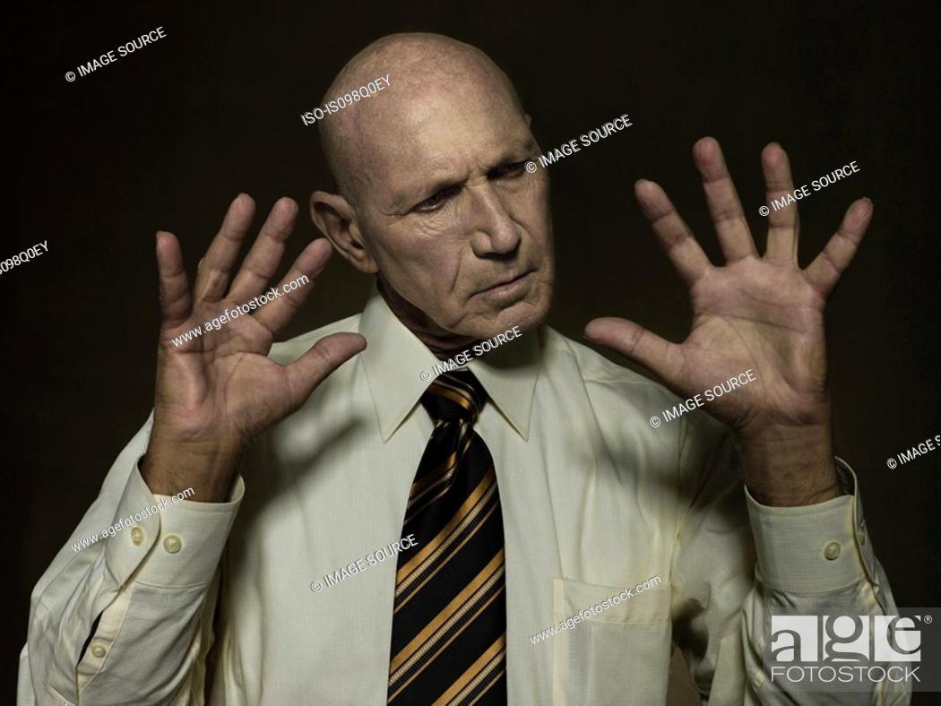 Stock Photo: Portrait of a mature man thinking.