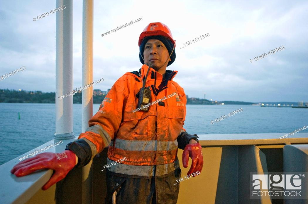 Stock Photo: Stockholm, Sweden. An Indonesian seaman or sailor on the container-vessel MV Flintercape, during a journey from Rotterdam, Netherlands, to Sundsvall, Sweden.