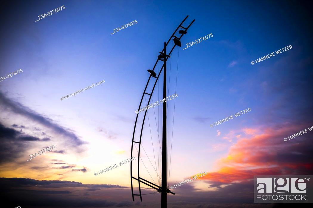 Stock Photo: Sunset with lamp post at the coastline of Las Palmas de Gran Canaria, Canary Islands.