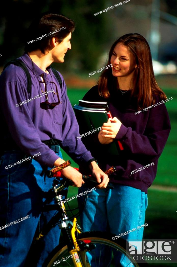 Stock Photo: young man and woman talking.