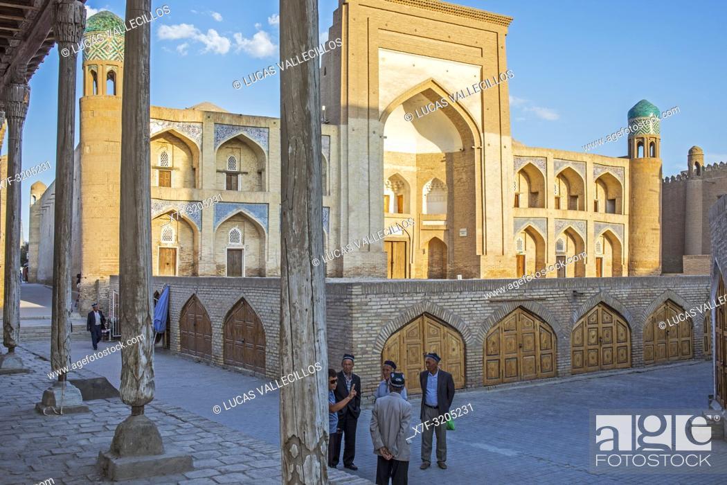 Stock Photo: Street scene in Ichon-Qala, old city, in background Qutlug Murod Inoq medressa, Khiva, Uzbekistan.