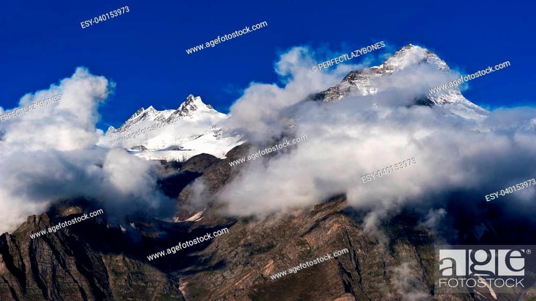 Stock Photo: Himalaya high mountain landscape panorama with snow cup at dawn. India, Himachal Pradesh, Keylong village.