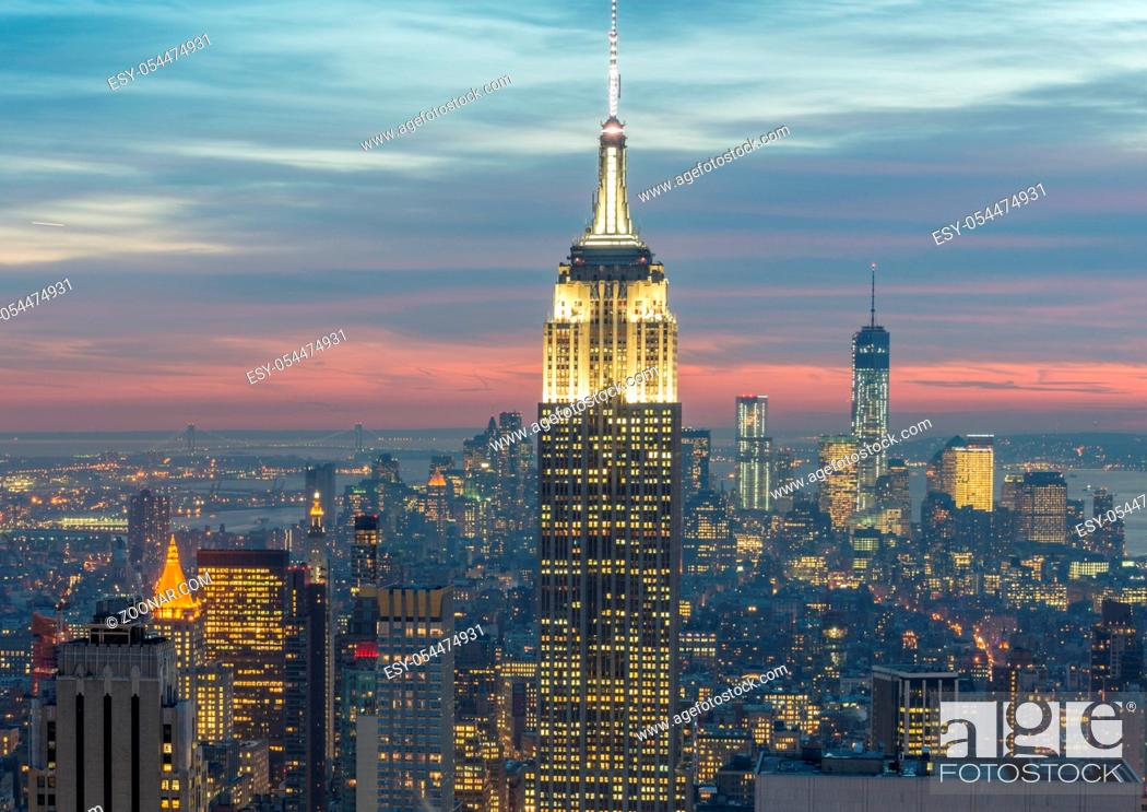 Stock Photo: The view of new york manhattan during sunset hours.