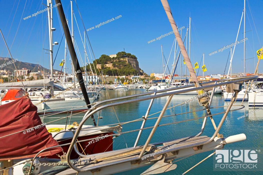 Imagen: Denia, Alicante Province, Costa Blanca. Spain. The castle and waterfront seen over the yacht harbour.