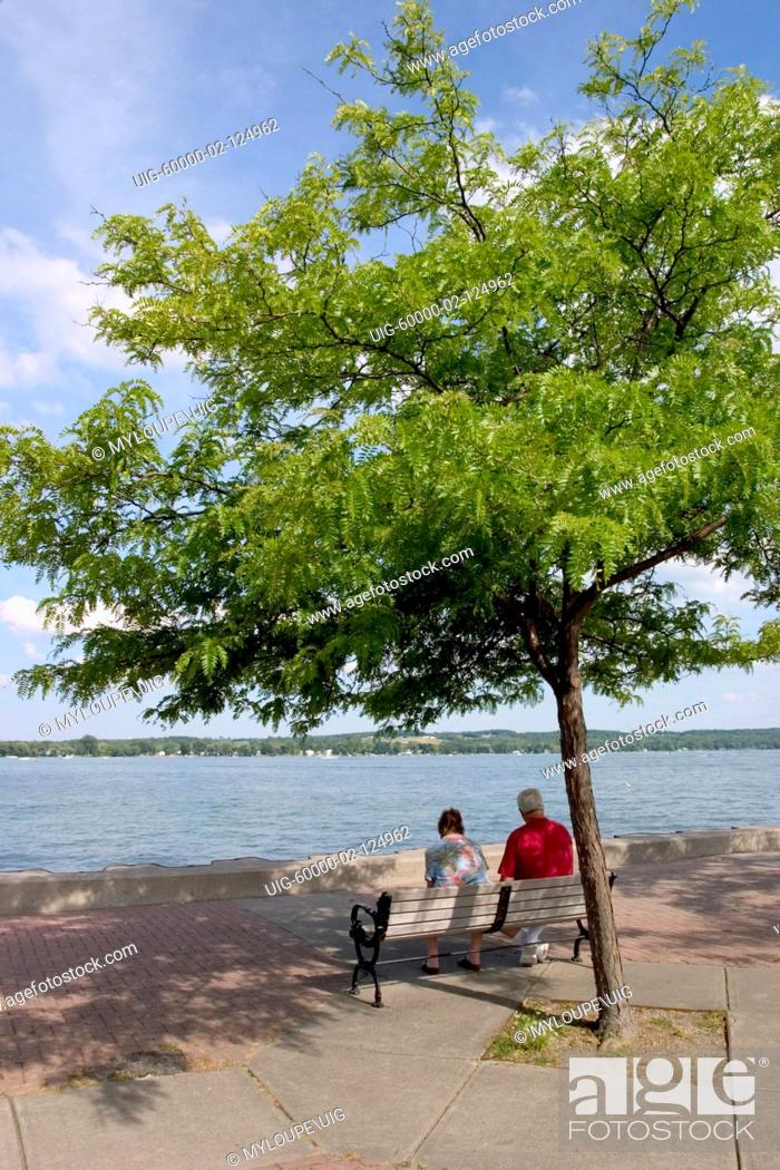 Stock Photo: Couple on pier on Canandaigua Lake in the Finger Lakes region of New Yrok State.