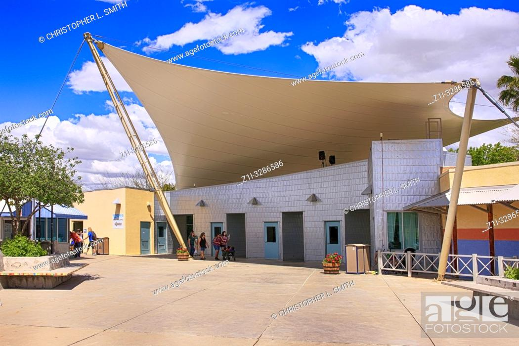 Stock Photo: Giant canopy shading the people inside the entrance to Reid Park Zoo in Tucson Arizona.