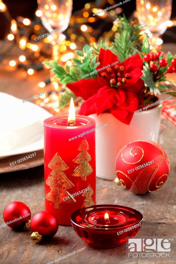 Photo de stock: Candles and ornaments on holiday table.