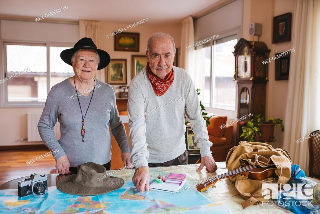 Stock Photo: Elderly couple planning a trip on a map.