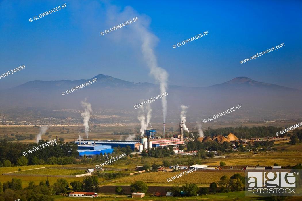 Stock Photo: Smoke emitting from smoke stacks, Morelia, Michoacan State, Mexico.