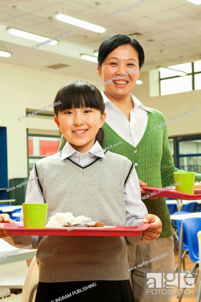 Stock Photo: Teacher and school girl portrait in school cafeteria.
