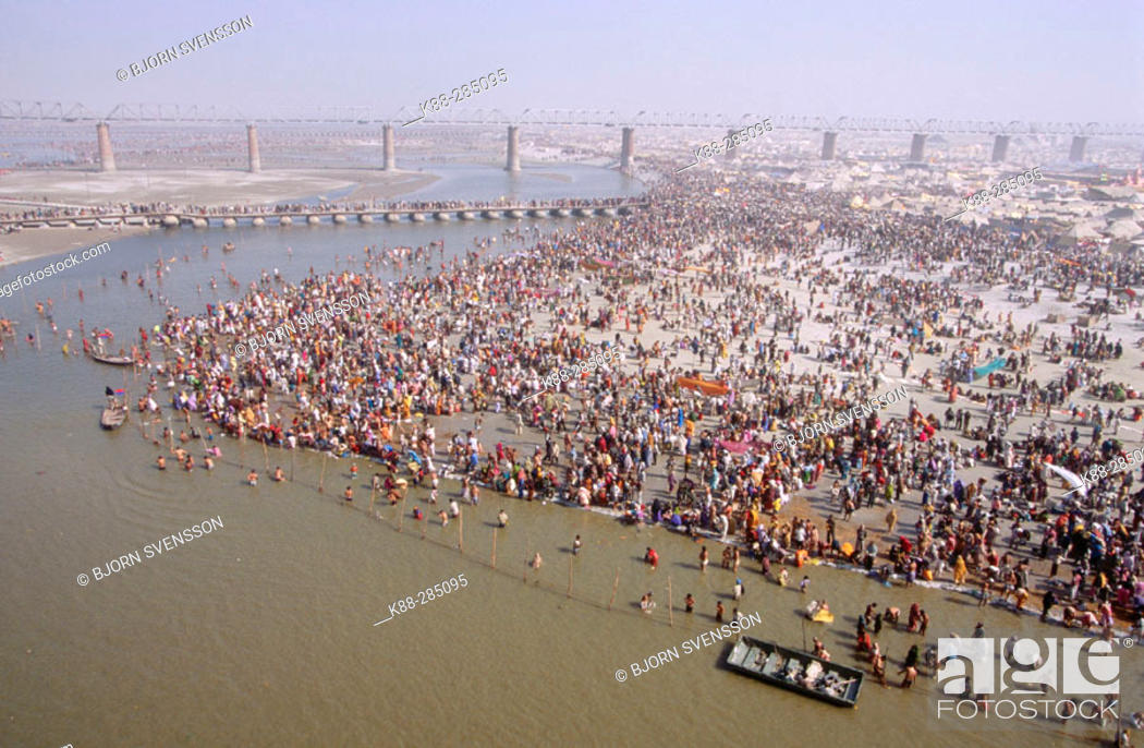 Stock Photo: Masses of pilgrims on the banks of the Ganges River during the Kumbh Mela Festival (2001), the largest religious event in the world. Allahabad, India.