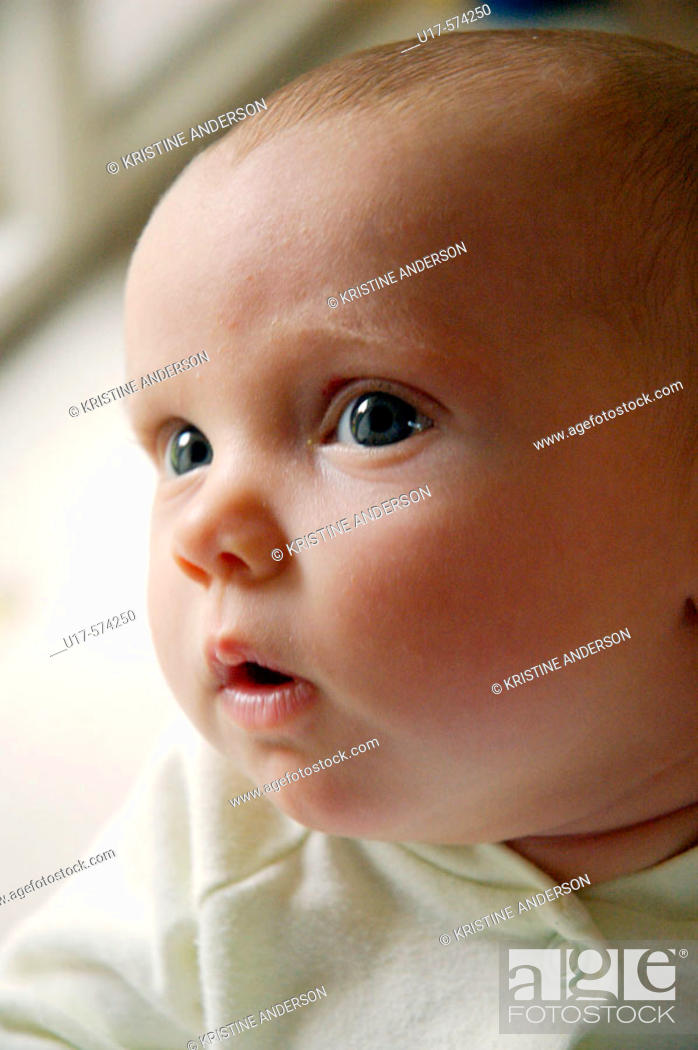 Stock Photo: Infant girl looking off to the side.