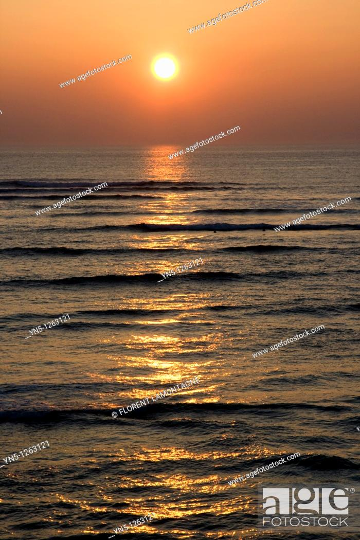 Stock Photo: Sunset on the ocean along the french shore.