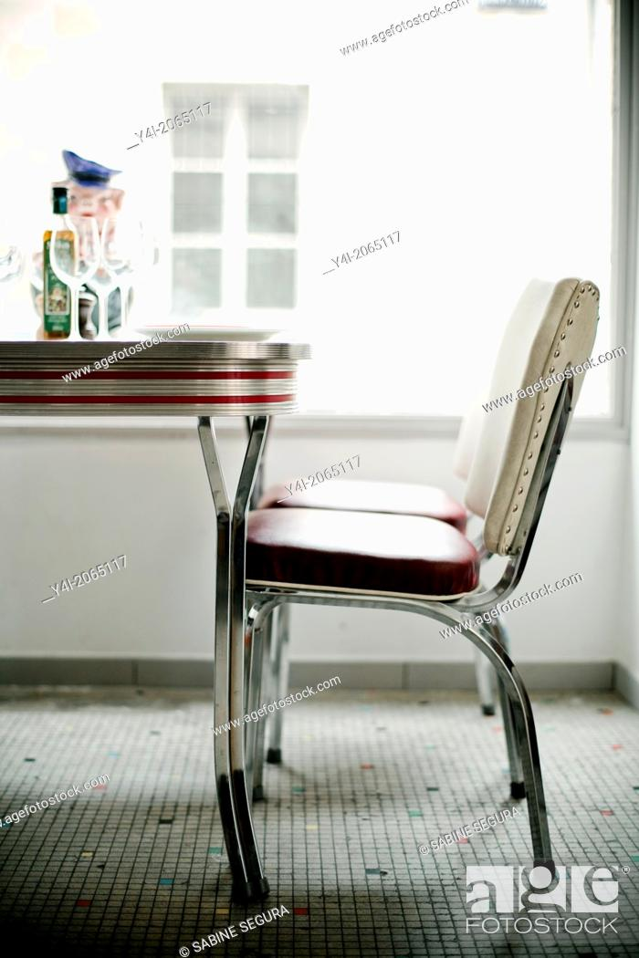 Stock Photo: Chair and table. Le Comestible. French restaurant in Bordeaux. Bordeaux. Gironde. Aquitaine. France. Europe.