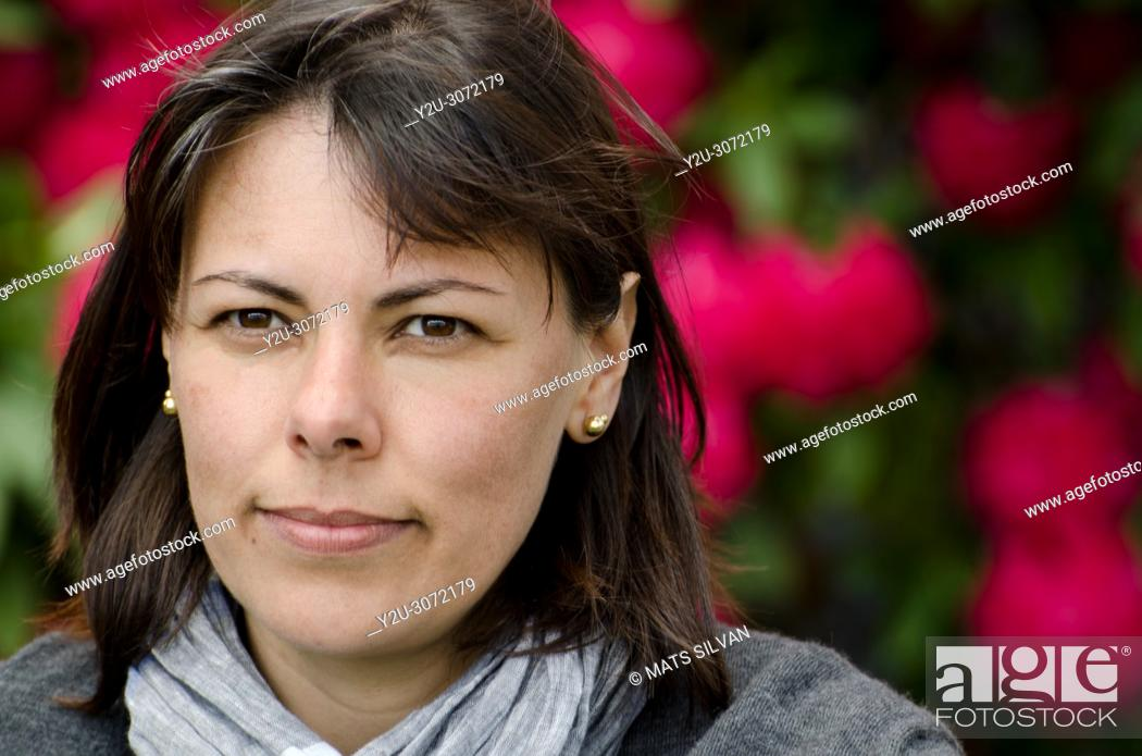 Stock Photo: Close Up on a Self Confident Woman with Flowers in Background in Ascona, Switzerland.