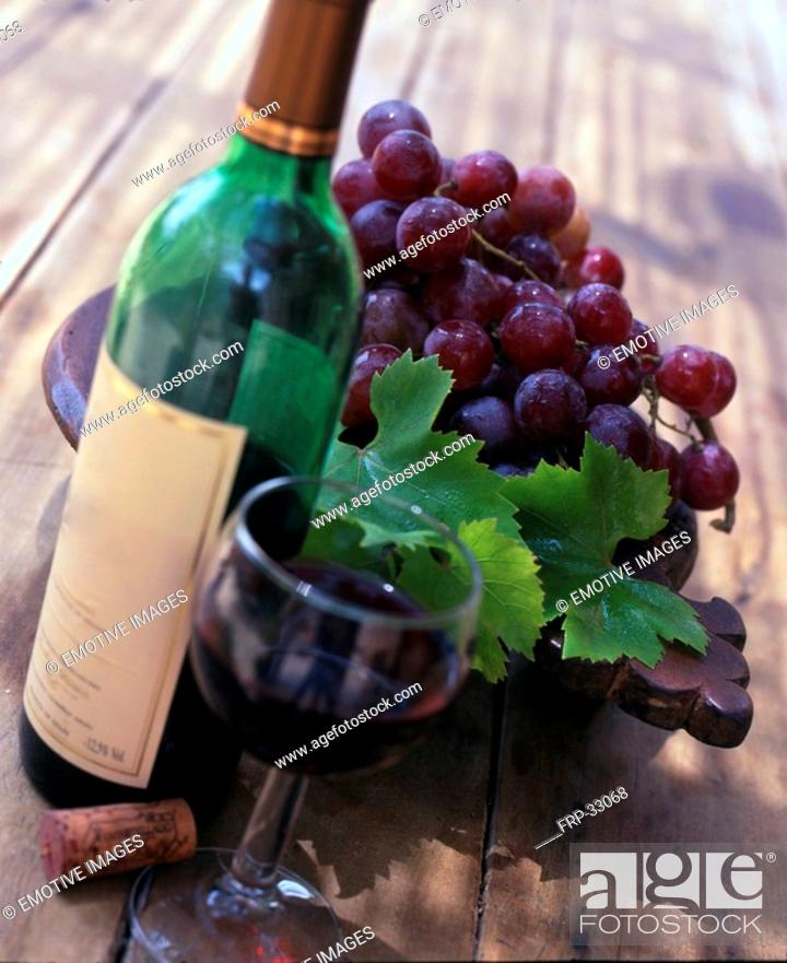 Stock Photo: Red wine and grapes.
