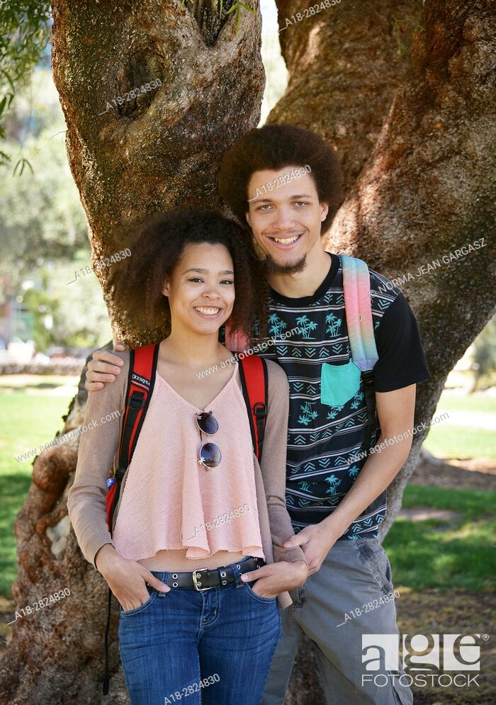 Stock Photo: A young woman and man on a college campus.