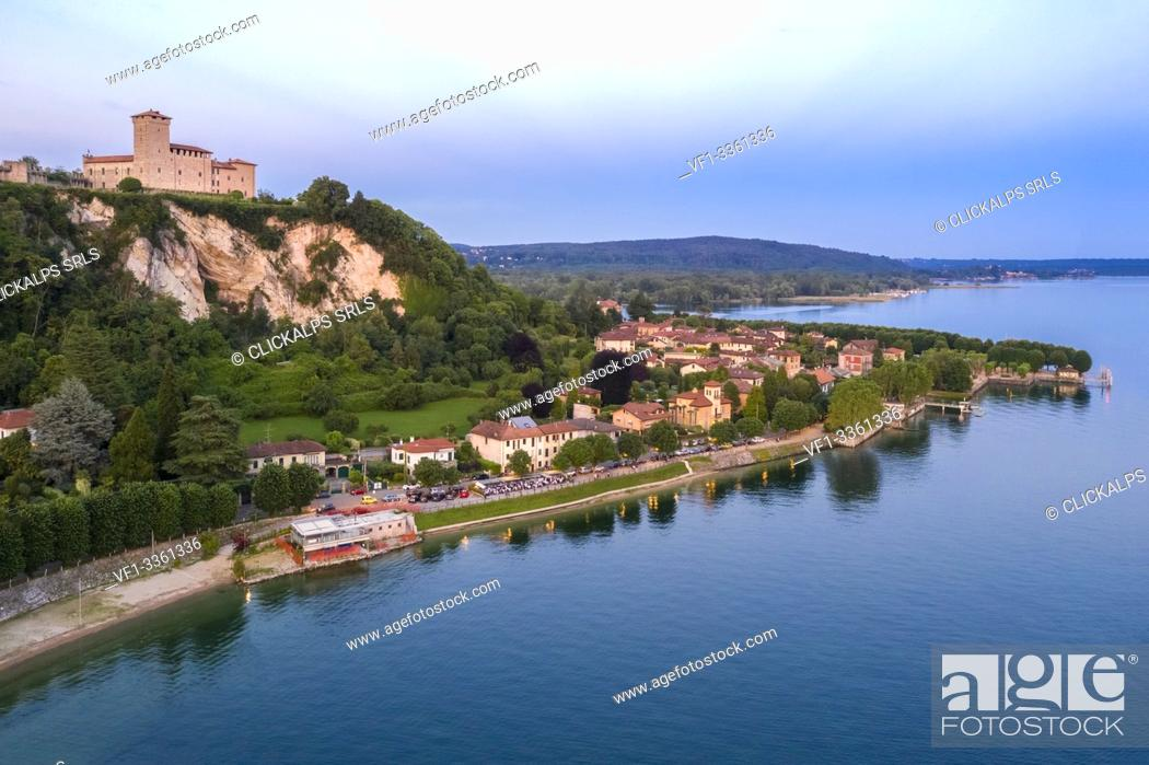 Stock Photo: View of the fortress called Rocca di Angera during a spring sunset. Angera, Lake Maggiore, Varese district, Lombardy, Italy.