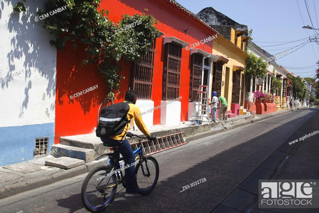 Stock Photo: Cyclist in front of the colonial buildings at the historic center, Cartagena de Indias, Bolivar, Colombia, South America.