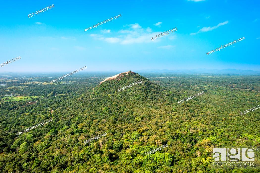 Stock Photo: View to the Pidurangala rock, a few kilometers north of the historical fort Sigiriya.