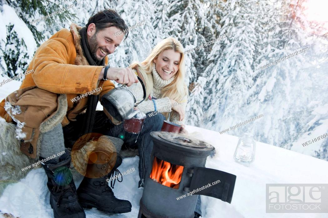 Stock Photo: Austria, Salzburg County, Couple sitting near camping stove and drinking tea.