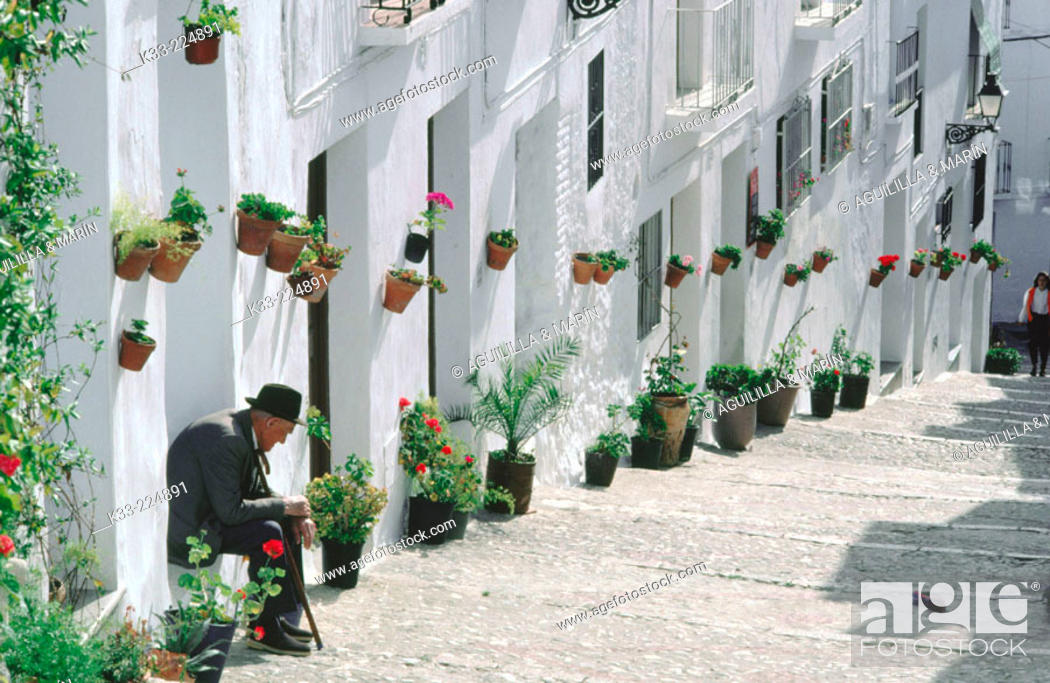 Stock Photo: A typical street of Frigiliana in Axarqía. Malaga province. Andalusia. Spain.