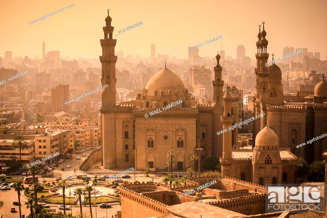 Stock Photo: Minarets of Sultan Hassan mosque and el rifaie mosque. cairo. at sunset, view from citadel.