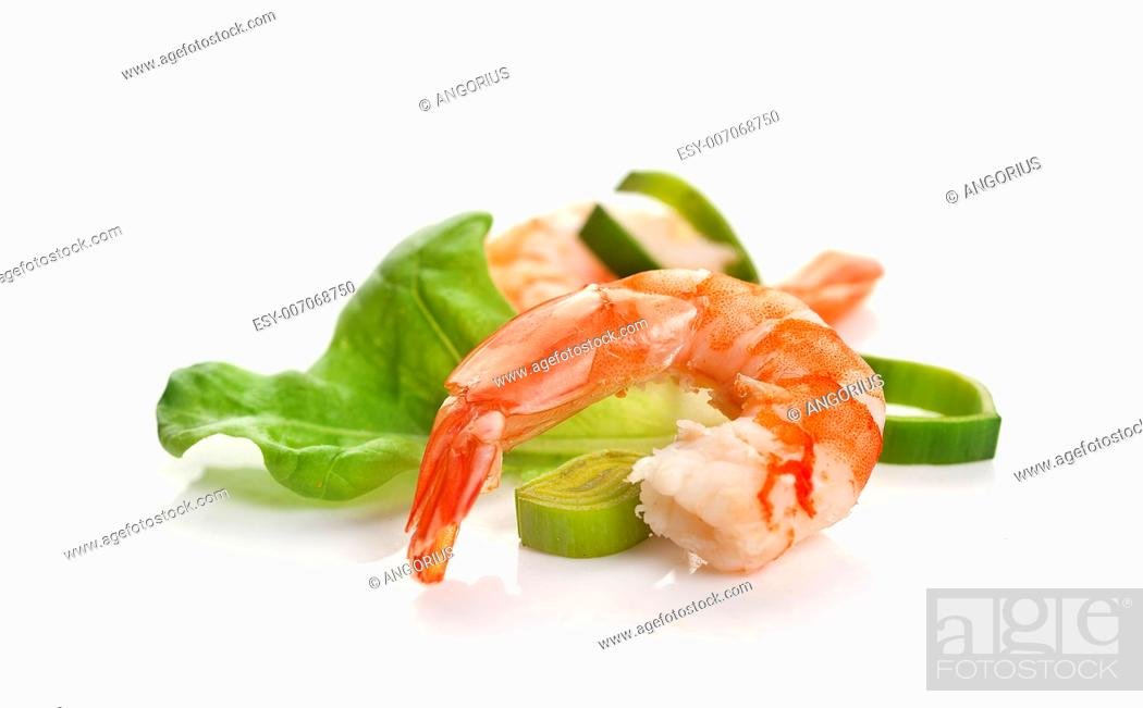 Stock Photo: One boiled shrimp's tail with lettuce, leek and lemon on the white background.