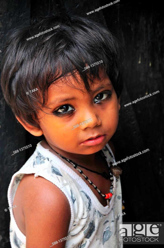 Stock Photo: Young girl at the narrow street of the old town near the Ganges River.