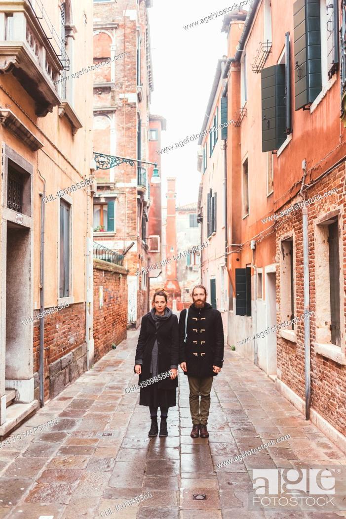 Stock Photo: Portrait of couple in street, Venice, Italy.