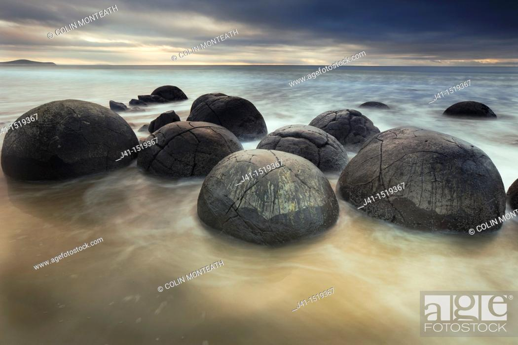 Stock Photo: Moeraki boulders, sombre winter dawn, near Oamaru, Otago, South Island, New Zealand.