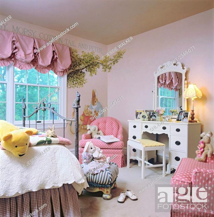 Stock Photo Children S Bedroom Little Room Shades Of Pink Used Throughout White Dresser Peter Rabbit Theme Mural Painted On Walls