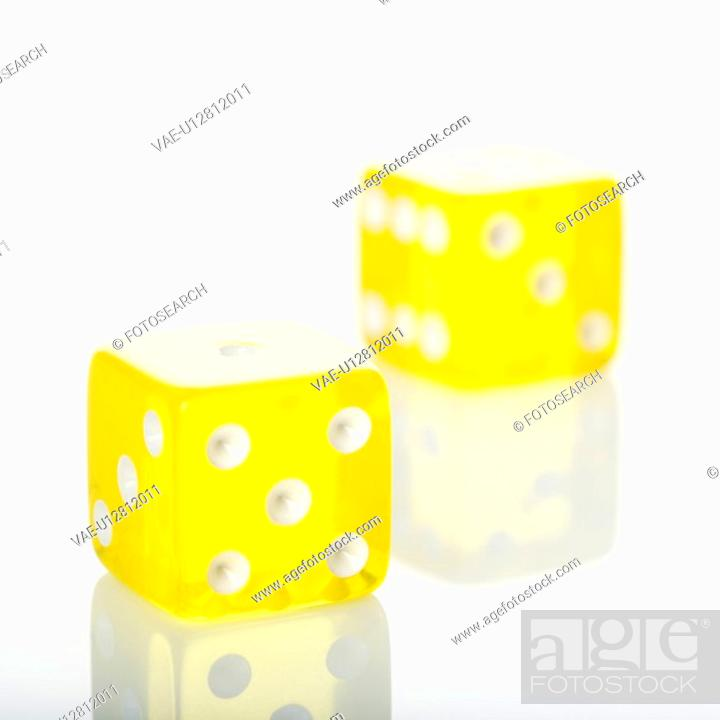 Stock Photo: Two yellow dice.