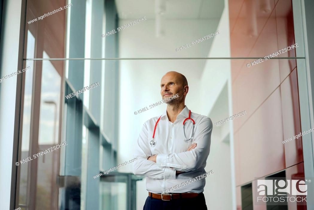 Stock Photo: Doctor standing in hospital with stethoscope around his neck.