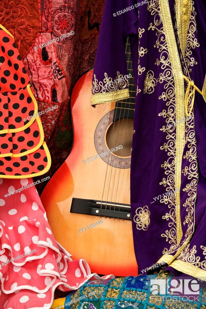 Stock Photo: Between Moorish flamenco guitar and flamenco dresses  Córdoba's shop.