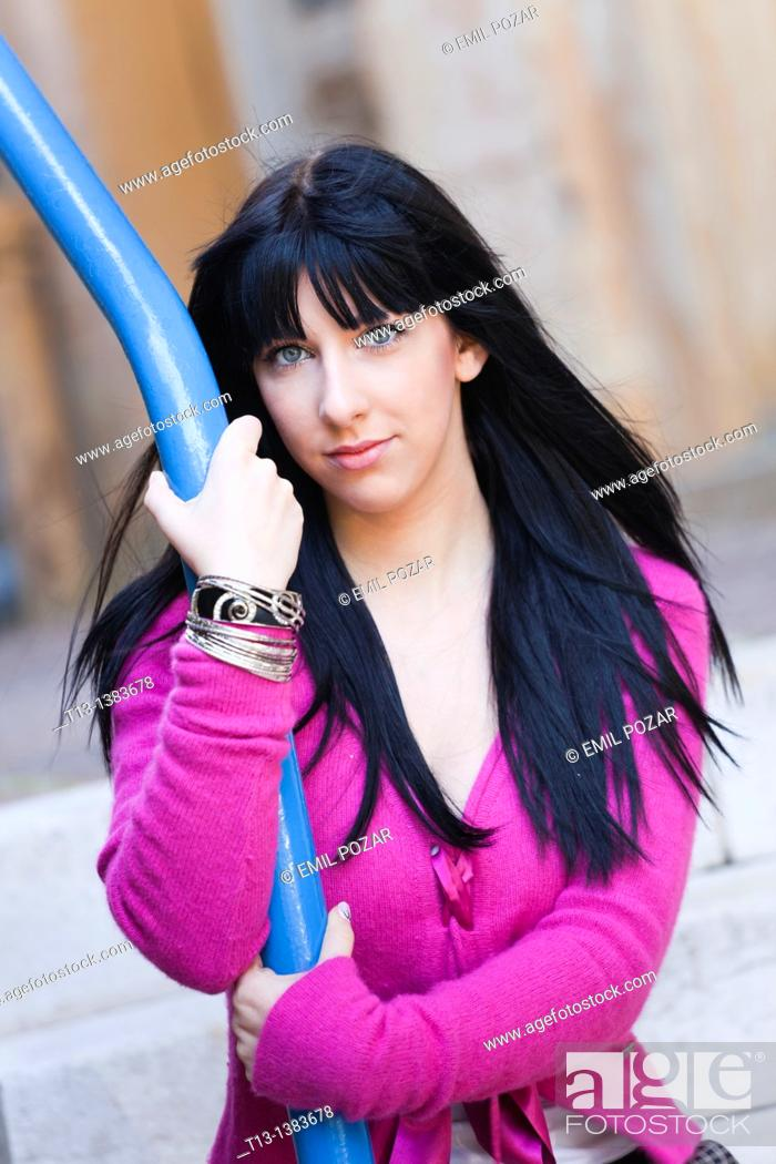 Stock Photo: Attractive woman in a Violet clothing portrait.