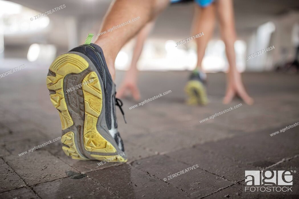 Stock Photo: Shoe of sportive man stretching.