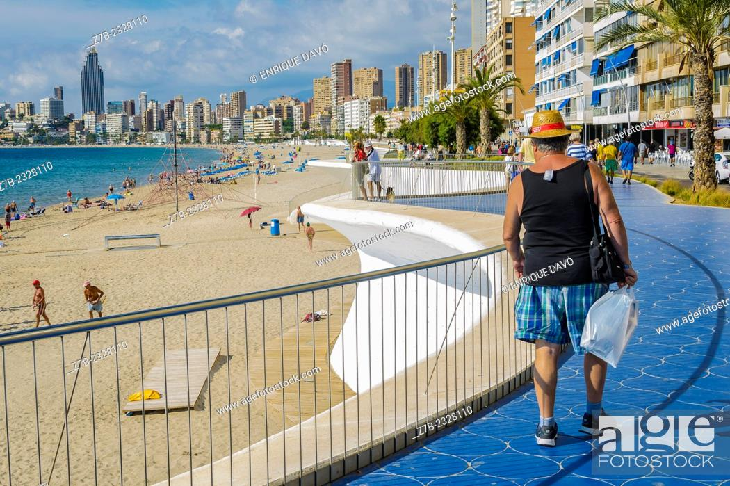 Stock Photo: View of a man with a straw hat in Benidorm beach, Alicante north, Spain.