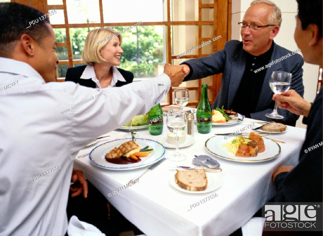 Stock Photo: Business People Shaking Hands at a Business Lunch.